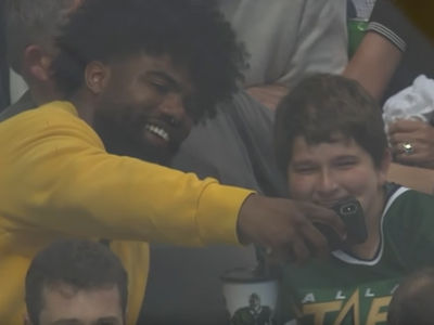 Ezekiel Elliott Rushes to Kid Hit By Puck at NHL Playoff Game
