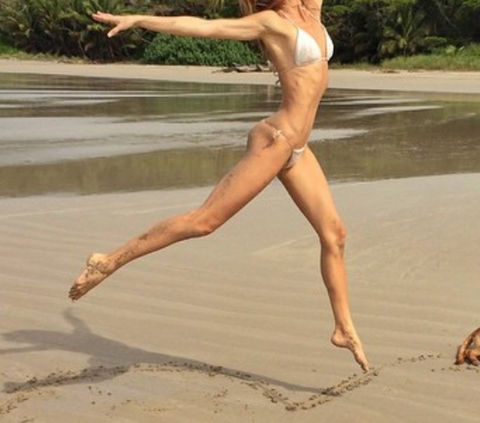 Guess the bikini babe leaping at the beach!
