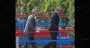 Barack Obama and George Clooney Take a Boat Ride in Italian Lake