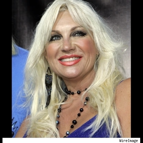 Linda Hogan, wife of Hulk, in her Suzanne Somers/Donatella Versace drag.